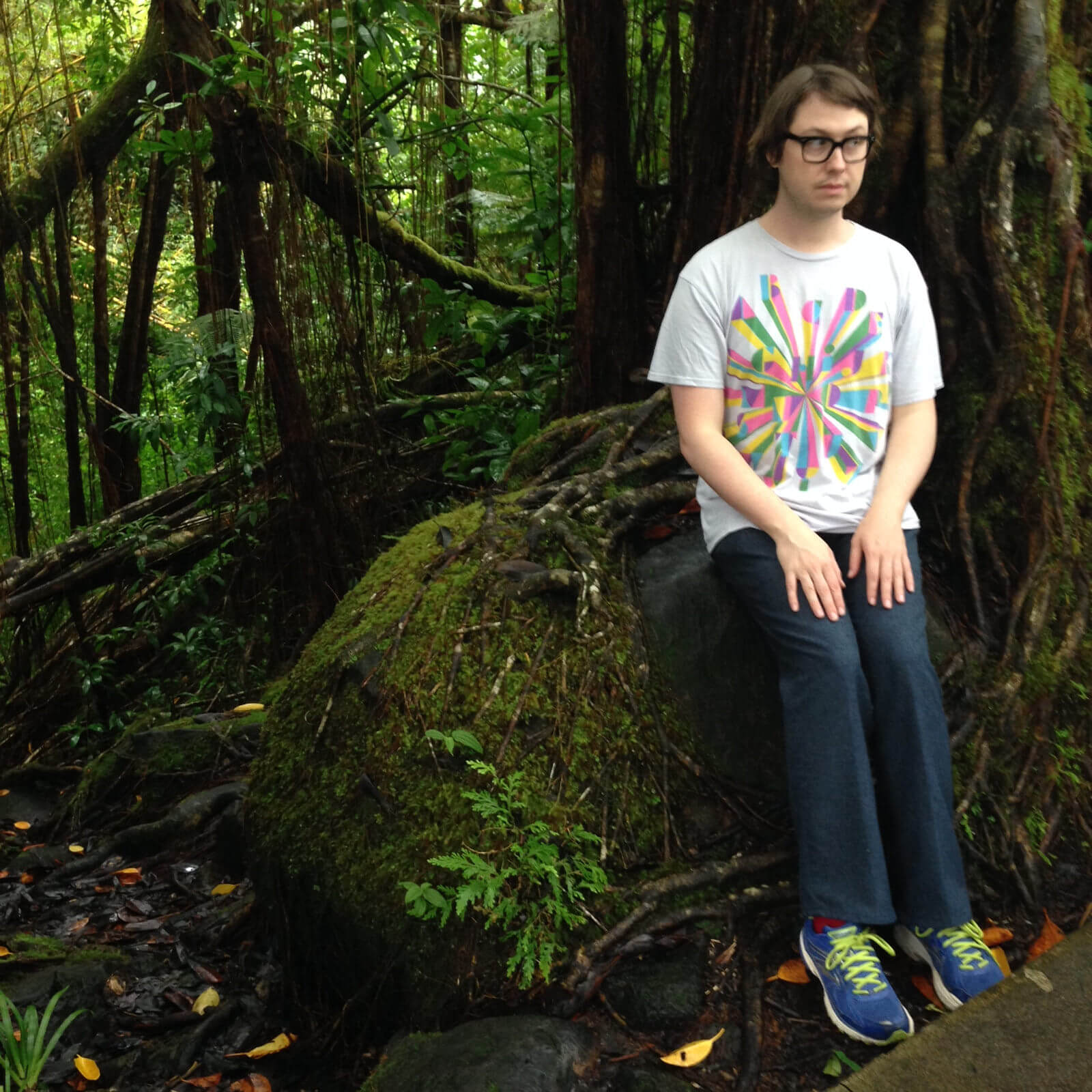 A photograph of Wiley Wiggins at the edge of a rainforest